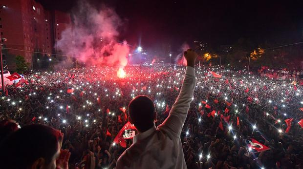 Ekrem Imamoglu waves to supporters at a celebratory rally in Istanbul (AP)