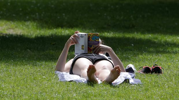 A woman sunbathes in a park in Lille, northern France (Michel Spingler/AP)