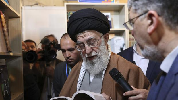Donald Trump signed an executive order on Monday targeting Iran's supreme leader and his associates with financial sanctions (Office of the Iranian Supreme Leader via AP)