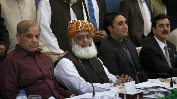 Pakistan's opposition parties leaders, from left, Shahbaz Sharif, Maulana Fazal-ur-Rehman and Bilawal Bhutto Zardari and Yousuf Raza Gillani attend an all-parties conference in Islamabad, Pakistan (Anjum Naveeed/AP)
