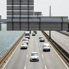 Vehicles drive on the road in Lyon as authorities issued a ban on older cars for the day (Laurent Cipriani/AP)