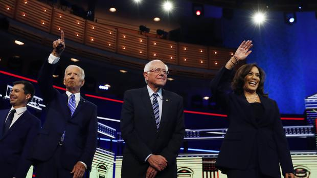 Democratic presidential candidates before the start of the primary debate in Miami (Brynn Anderson/AP)