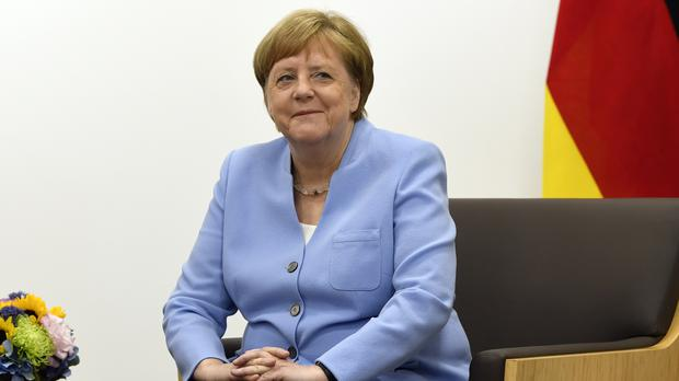 German Chancellor Angela Merkel has insisted she is 'fine' after being seen shaking for the second time in a week (Susan Walsh/AP)