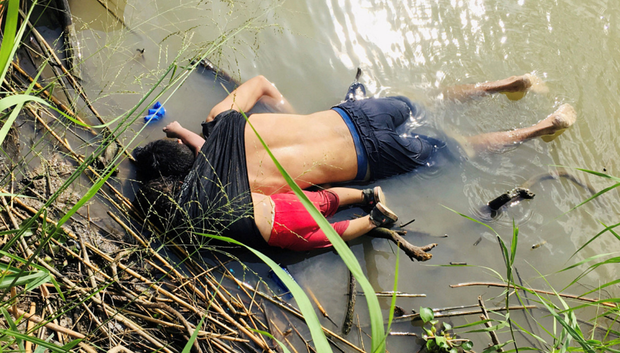 TRAGEDY: The photograph of Oscar Alberto Martinez Ramirez and his toddler daughter Valeria lying face down on the banks of the Rio Grande river between the United States and Mexico. Photo: Reuters