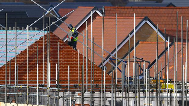 The previously resilient house building sector suffered its fastest drop in three years (PA)