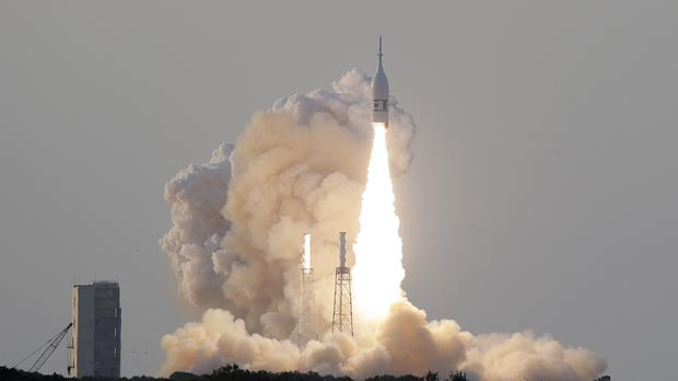 A NASA Orion spacecraft lifts off from Cape Canaveral (AP Photo/John Raoux)