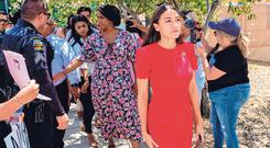 Fact finding: Alexandria Ocasio-Cortez leads the group of politicians touring the Border Patrol migrant detention centres In Texas. Photo: Getty