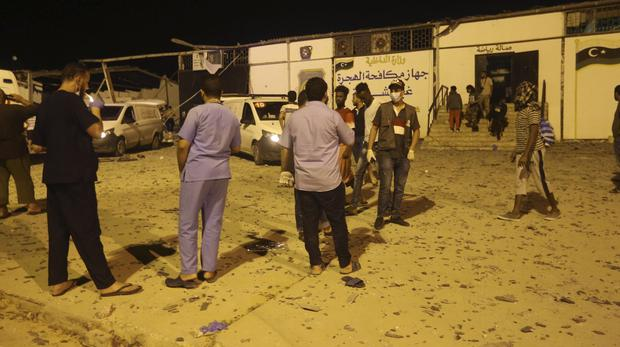 Workers gather at a detention center after an airstrike in Tajoura, east of Tripoli Wednesday (Hazem Ahmed/AP)