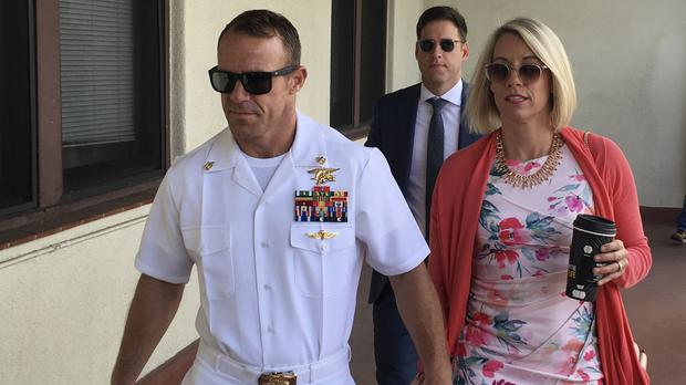 US Navy officer Edward Gallagher has been sentenced for posing with a war casualty (Julie Watson/AP)