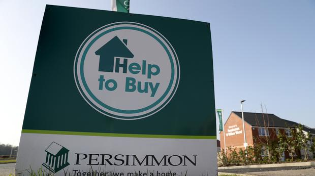 Housebuilding giant Persimmon revealed a drop in half-year sales as it said improving customer service remains its 'top priority' (Andrew Milligan/PA)
