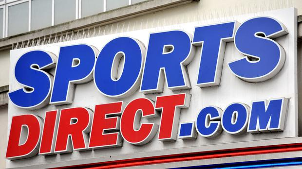 File photo dated 11/06/15 of a Sports Direct sign. Mike Ashley's company will update the market on Thursday.