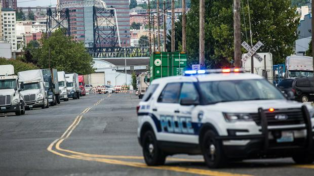 Police guard a road block near the Northwest Detention Centre in Tacoma, Washington state(Rebekah Welch/The Seattle Times/AP)