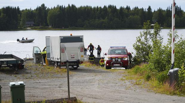 Emergency services attend the accident site at a small harbour outside Umea, Sweden (Samuel Pettersson/TT via AP)