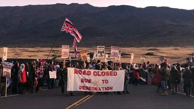 Demonstrators gather to block a road at the base of Hawaii's tallest mountain (Caleb Jones/AP)