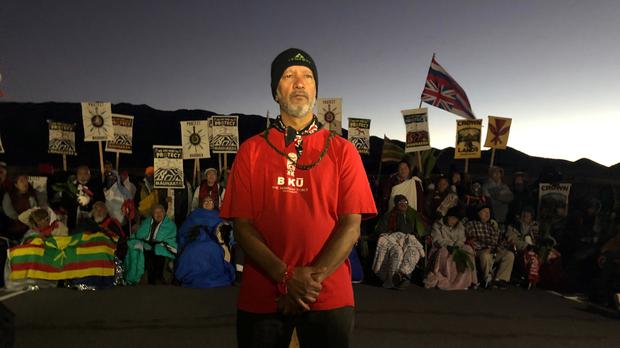 Demonstrators gathered to block a road at the base of Hawaii's tallest mountain (AP)