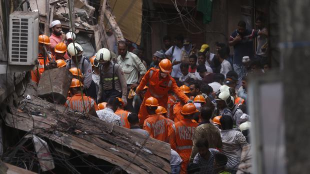 Rescuers work at the site (AP)