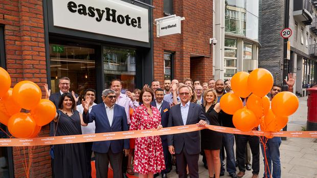 Guy Parsons, CEO easyHotel and Kate Nichols, CEO UK Hospitality cut a ribbon at the opening of a new easyHotel, Old Street (Professional Images/@ProfImages/PA)