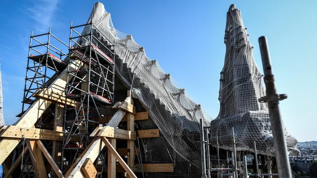 Scaffolding is seen during preliminary work on top of Notre Dame Cathedral (Stephane de Sakutin/AP)