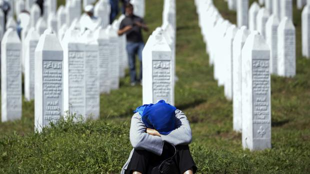 Bosnian Serb forces massacred Muslim men in Srebrenica (Darko Bandic/AP)