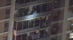 A man climbed down the side of a 19-storey high-rise building in Philadelphia (WPVI-TV via AP)