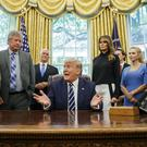 Donald Trump with Apollo 11 astronauts Michael Collins, left, and Buzz Aldrin, right, and Eric 'Rick' Armstrong, son of Neil Armstrong, second from left, with Vice President Mike Pence and first lady Melania Trump (Alex Brandon/AP)