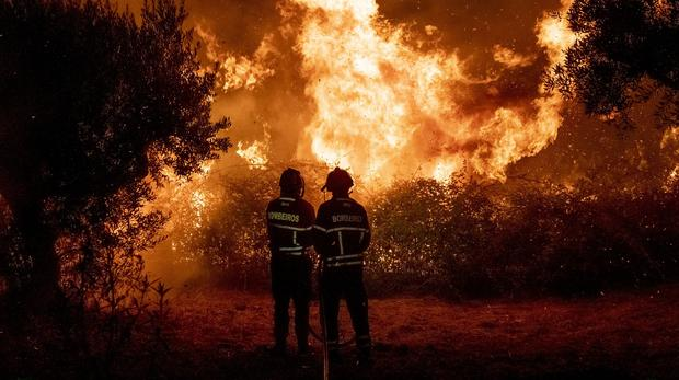 Firefighters try to extinguish a wildfire in central Portugal (Sergio Azenha/AP)