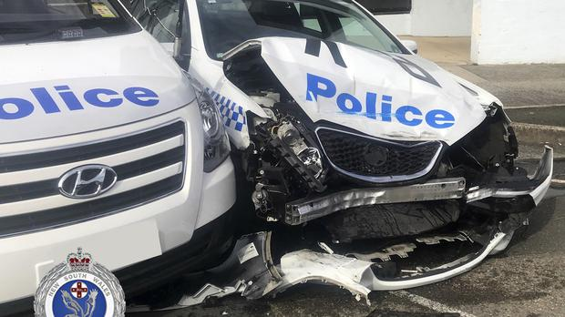 A damaged police vehicle at a police station in Sydney (NSW Police via AP)
