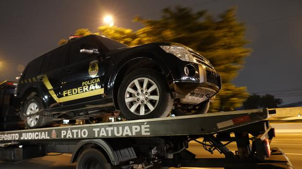 A fake police vehicle that was used in robbery is transported on a flat-bed lorry (Victor R. Caivano/AP)