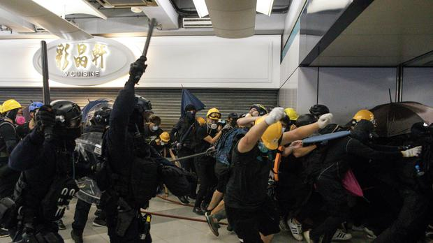 Police use batons against protesters who refused to leave a train station in the Yuen Long are of Hong Kong (Eric Tsang /HK01 via AP)