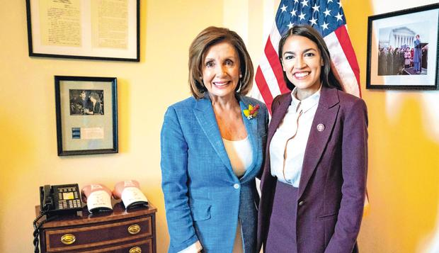 Resisting calls to impeach Trump: US Speaker of the House Nancy Pelosi poses with Democrat Rep Alexandria Ocasio-Cortez in her office at the US Capitol in Washington. Photo: Reuters