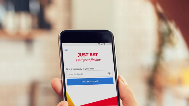 Just Eat profits plummet on investment in delivery