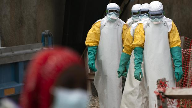 Health workers in the Democratic Republic of Congo begin their shift at an Ebola treatment centre (AP/Jerome Delay)