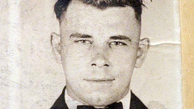 FILE – This file photo shows Indiana Reformatory booking shots of John Dillinger, stored in the state archives, and shows the notorious gangster as a 21-year-old. Records show that Dillinger was admitted into the reformatory on Sept. 16, 1924. The body of the 1930s gangster is set to be exhumed from an Indianapolis cemetery more than 85 years after he was killed by FBI agents. The Indiana State Department of Health approved a permit July 3, 2019, that Dillinger's nephew, Michael C. Thompson, sought to have the body exhumed from Crown Hill Cemetery and reinterred there.(AP Photo/The Indianapolis Star, Charlie Nye, File)