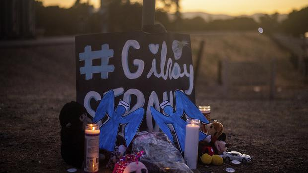 Candles burn at a makeshift memorial for Gilroy Garlic Festival shooting victims (AP Photo/Noah Berger)