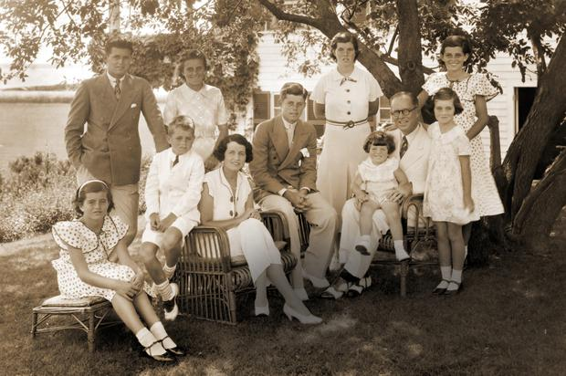 ILL-STARRED: Joseph P Kennedy with his wife and his nine children in Hyannis Port in the 1930s. Sitting from bottom left, Patricia, Robert, wife Rose, JFK and Edward; standing from left, Joe Jr, Kathleen, Rosemary, Eunice and Jean