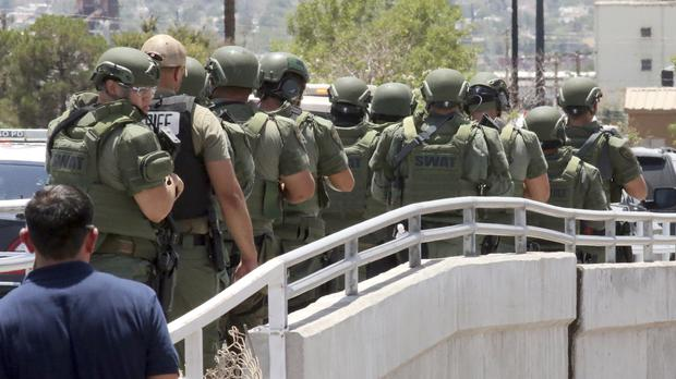 Law enforcement officers make their way to the scene of a shooting at a shopping centre in El Paso, Texas (Rudy Gutierrez/AP)
