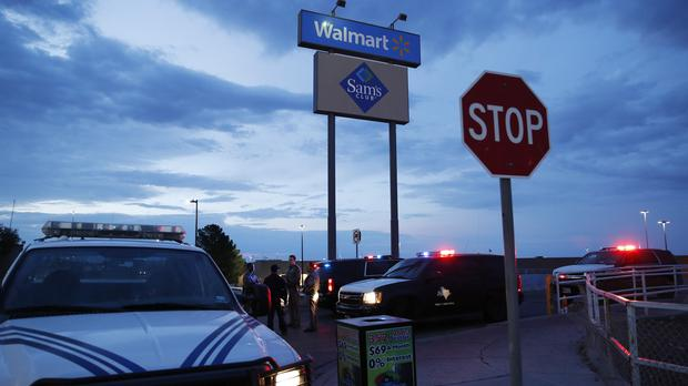 Law enforcement officials block a road at the scene of a mass shooting at a shopping complex in El Paso, Texas (John Locher/AP)