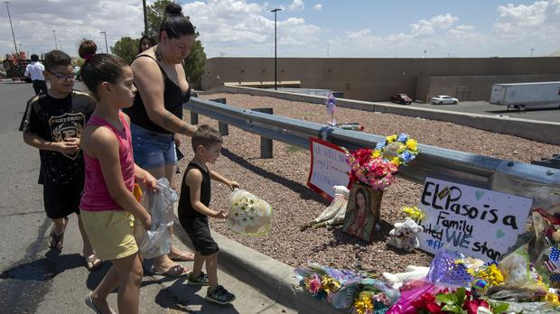 Flowers are laid at the makeshift memorial for the victims of the mass shooting at a shopping complex in El Paso, Texas (AP Photo/Andres Leighton)