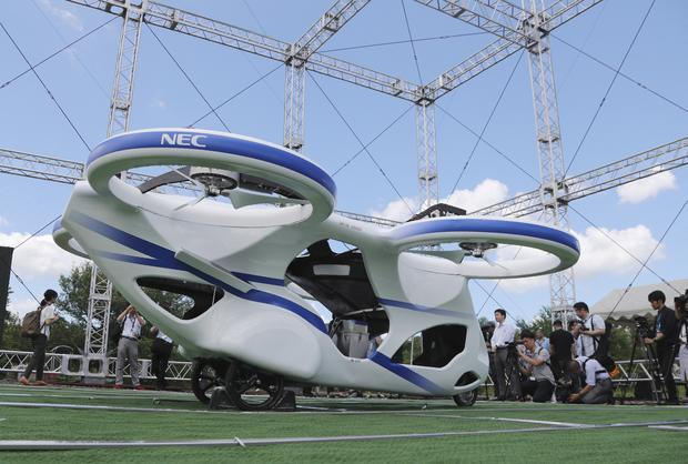 'Flying car' hovers steadily in test flight by Japanese electronics company NEC