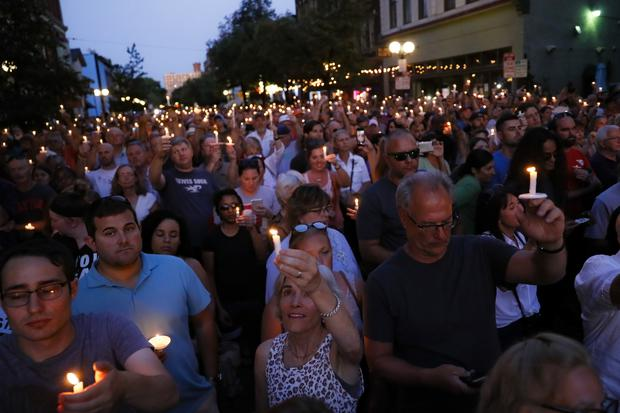 Mourners gather for a vigil at the scene of the mass shooting in Dayton, Ohio (AP)