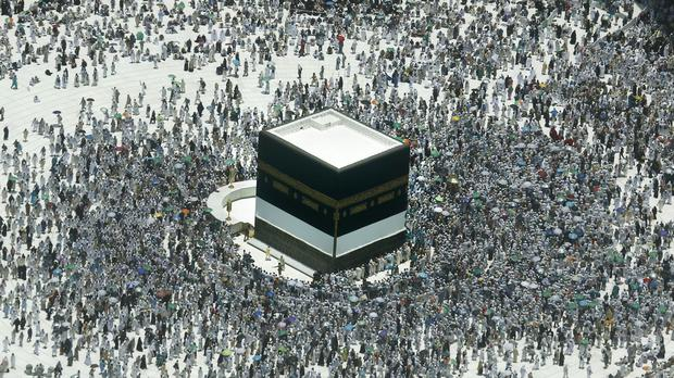 Muslim pilgrims circumambulate around the Kaaba, the cubic building at the Grand Mosque, in the Muslim holy city of Mecca (Amr Nabil/AP)
