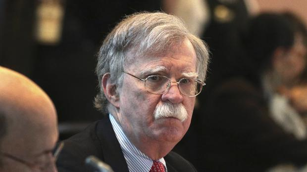 US national security adviser John Bolton said the US will target anybody at home or abroad who supports the government of Venezuelan president Nicolas Maduro with stiff financial sanctions (AP)