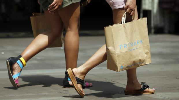 General view of shopper with Primark bag on Oxford Street, London during warm summer weather. The high street suffered a bleak July as soaring temperatures failed to boost sales in July (PA)