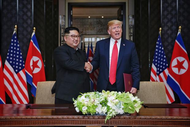 Kim Jong Un and Donald Trump in Singapore (Kevin Lim/Straits Times/PA)