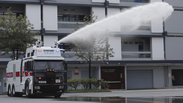 An anti-riot vehicle equipped with water cannon during a demonstration at the Police Tactical Unit Headquarters in Hong Kong (Kin Cheung/AP)