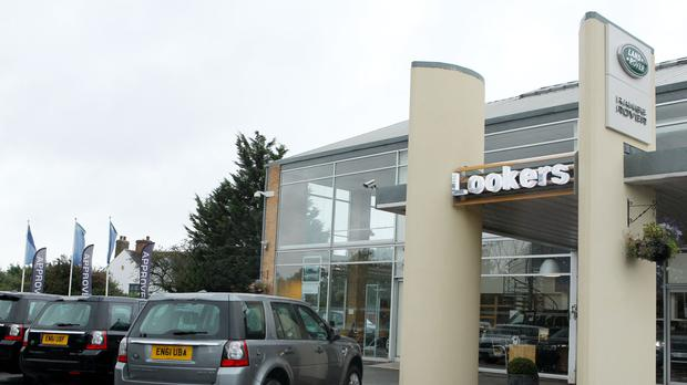 Lookers is suffering from the downturn in the car sales market (PA)