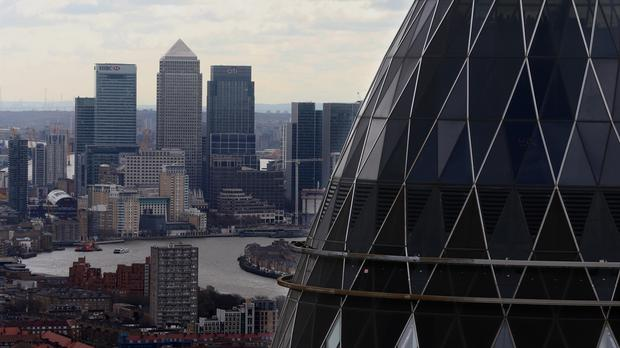 The London skyline as seen from Tower 42 with the 'Gherkin' (foreground), 30 St Mary Axe and Canary Wharf (background) prominent. Stock markets around the world plunged over fears of a recession (PA)