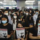 Demonstrators at Yuen Long station (AP Photo/Kin Cheung)