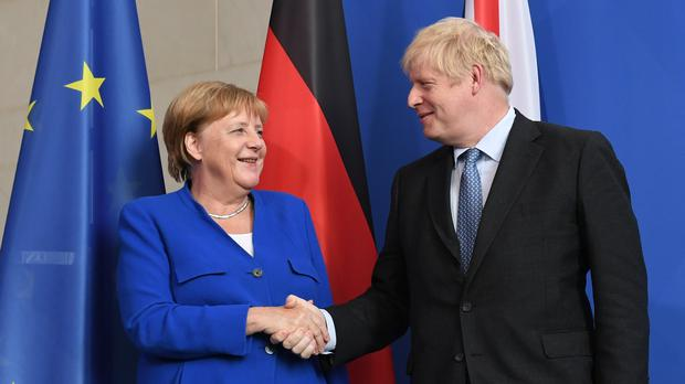 Prime Minister Boris Johnson with German Chancellor Angela Merkel in Berlin (PA)