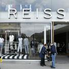 Upmarket fashion retailer Reiss has shrugged off the high street downturn to deliver soaring sales over the first half of the year (Jonathan Brady/PA)
